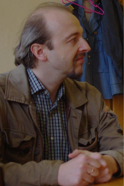 Олег Белей